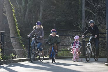A young family cycling on the Isle of Wight