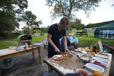 James Tanner Preparing a pizza on the Isle of Wight