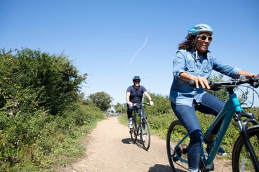 A couple on a cycle route through countryside near Yarmouth Isle of Wight