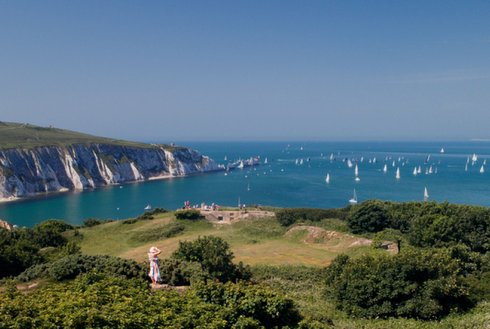 View from the Isle of Wight showing the sea, sailing boats, and cliffs
