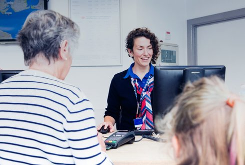 Wightlink team member assisting customers