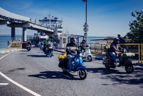 Motorcycle scooters leaving Fishbourne