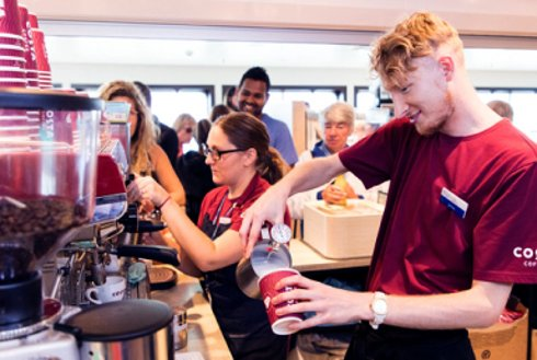 Crew staff creating drinks on board Wightlink ferry