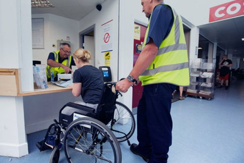 Wheelchair user purchasing a Blue Badge discount ferry ticket