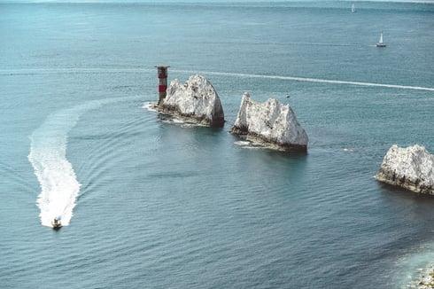 Pleasure boat cruises past The Needles