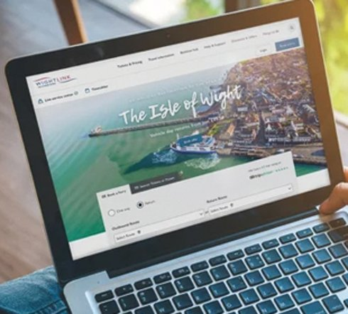 How to book your Wightlink travel on our website - a picture of a laptop with the Wightlink website on the screen