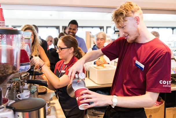 Costa staff pour drinks on board Wightlink ferry