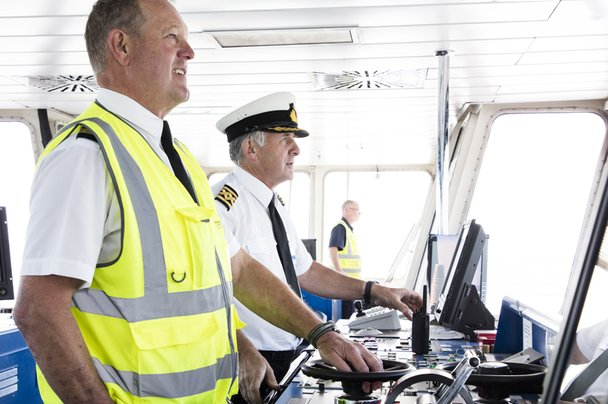 Wightlink captain and crew on bridge of ferry