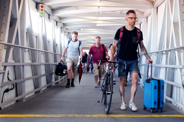 Foot passenger with bicycle boards FastCat ferry